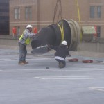 Two HighLine Rigging Employees Moving Large Construction Piece with Crane