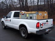 White Haul Truck with Box in Bed from HighLine Rigging LLC